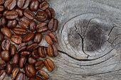 Fresh Roasted Coffee Beans On Rustic Wood