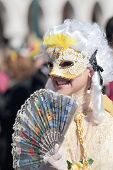 Young Masked Woman With Fan At The Carnival Of Venice