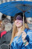 Woman Dressed In Blue With A Parasol Umbrella During The Carnival Of Venice