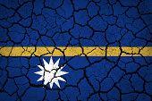 Nauru flag painted on cracked ground