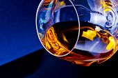 Snifter Of Brandy In Elegant Glass With Space For Text On Light Tint Blue Disco