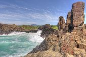 foto of natural phenomena  - A fair swell at Bombo kicked up large waves that smashed the clusters of hexagonal basalt columns which are an internationally recognised geological phenomena formed from volcanic action - JPG