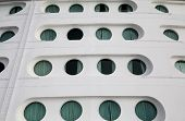pic of cruise ship caribbean  - Front of a massive luxury cruise ship with round portholes - JPG