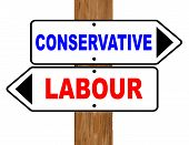 stock photo of labourers  - White and black labour and conservative signs with red and blue text fixed to a wooden pole over a white background - JPG