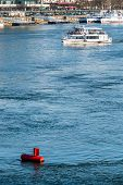 pic of oceanography  - red buoy water surface - JPG