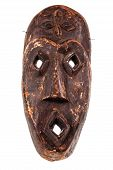 pic of cultural artifacts  - an ancient african wooden mask isolated over a white background - JPG