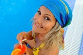picture of sunburn  - young woman at the pool on a warm summer day - JPG