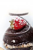 picture of chocolate spoon  - fresh chocolate strawberry mousse over white with silver spoon - JPG
