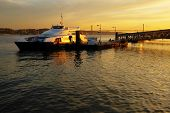 stock photo of dock  - Ferryboat docked ina pier in Lisbon at Sunset - JPG