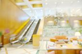 stock photo of reception-area  - Abstract blurry bright empty reception area in warm light ambient - JPG