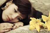 foto of tombstone  - Sad young woman lying on the tombstone  - JPG