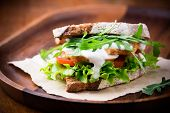 pic of tomato sandwich  - Rye toast sandwich with green leaf tomato and chicken selective focus - JPG