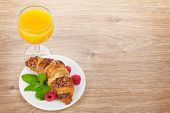 picture of croissant  - Orange juice and fresh croissant with berries on wooden table background with copy space - JPG