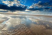 picture of tide  - sunshine over North sea beach at low tide Netherlands - JPG