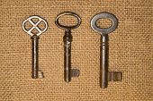 foto of hasp  - A lot vintage keys to the safe on a old cloth - JPG