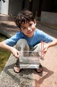 pic of catch fish  - Young boy enjoying a day catching and feeding fish in pond - JPG