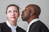 stock photo of toga  - man trying to lick a woman ear both wearing canadian lawyer toga - JPG