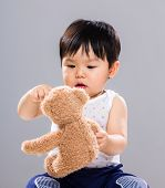 picture of baby doll  - Young baby son hold with doll bear - JPG