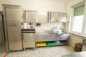 stock photo of dishwasher  - large industrial kitchen with refrigerator dishwasher and sink all stainless steel - JPG