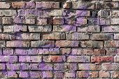 foto of brick block  - Old brick wall background with elements of paint - JPG