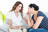image of therapist  - Depressed woman talking with her therapist on white background - JPG