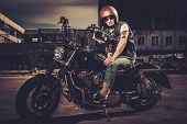 pic of carburetor  - Biker and his bobber style motorcycle on a city streets  - JPG