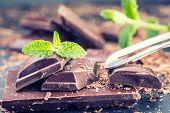 Постер, плакат: Chocolate Black chocolate A few cubes of black chocolate with mint leaves
