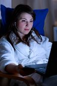 image of night gown  - Portrait of girl with headphones using laptop - JPG