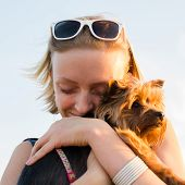foto of dog eye  - beautiful young happy woman with blonde hair blink her eyes and holding small dog - JPG