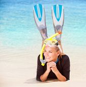 picture of flipper  - Happy diver woman lying down on the beach - JPG