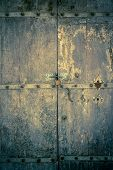 image of entryway  - aged dark vintage wooden door as background with cuttings and scratch  - JPG