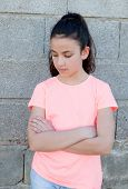 stock photo of  preteen girls  - Angry preteen girl with pink t - JPG