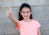 foto of  preteen girls  - Portrait of a beautiful preteen girl with blue eyes saying Ok - JPG