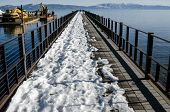 picture of pier a lake  - View of partly covered pier with snow Lake Tahoe - JPG