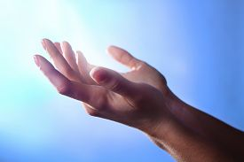 image of pray  - Woman praying on bright background - JPG