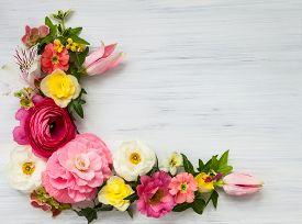 stock photo of rose flower  - Flowers frame on white wooden background - JPG