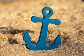 image of anchor  - The blue decirative anchor on a sandy beach  - JPG