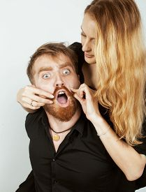 picture of fool  - young hipster couple fooling around on white background close up - JPG