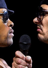 picture of gangsta  - Two rappers having a hip hop battle with a microphone - JPG