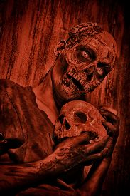 picture of doomsday  - Frightening bloody zombie man with a skull in blood - JPG