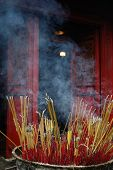 Incense Sticks Outside Of A Temple In Vietnam poster