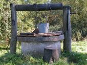 picture of water well  - old hand made well rural scenic at summer - JPG