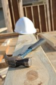 Claw Hammer And Hard Hat On Board