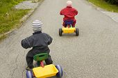 Children on tricycles