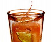 foto of iced-tea  - a high speed photograph of a picture of a lemon dropping in ice tea - JPG