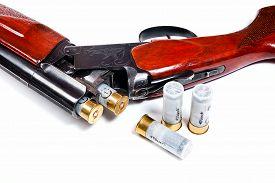 image of shotgun  - Hunting shotgun and ammunition on white background - JPG