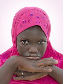 image of ten years old  - Moody girl wearing a pink headscarf - JPG