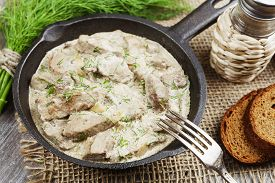 pic of liver fry  - Liver stewed in sour cream in a frying pan - JPG