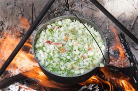 image of cauldron  - vegetables prepared in a cauldron over a fire on the nature - JPG