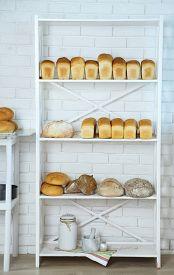 stock photo of bakeshop  - Bread on shelves in store - JPG